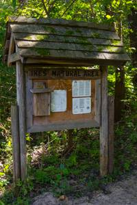 Trail kiosk along the Issac Walton League access containing trail map and natural information.
